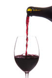 Red wine pouring down from a wine bottle isolated Stock Photos