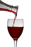 Red wine pouring down from a wine decanter Stock Photo