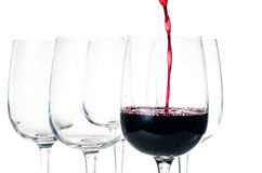 Red wine pouring into empty glass Stock Image