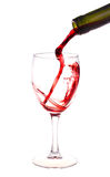 Red Wine Pouring From A Wine Bottle Royalty Free Stock Images