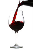 Red wine pouring in a glass Royalty Free Stock Photo