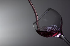 Red wine pouring in glass Royalty Free Stock Photo