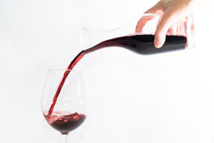 Red wine pouring into a glass Stock Image