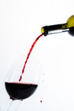 Red wine pouring into a glass Royalty Free Stock Photos