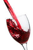 Red wine pouring in glass Royalty Free Stock Photos