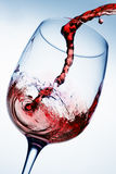 Red wine pouring into glass Royalty Free Stock Photos