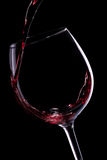 Red wine pouring in glass Royalty Free Stock Image