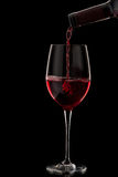 Red wine pouring in glass Stock Photography