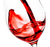 Red wine pouring in the glass goblet Royalty Free Stock Photography