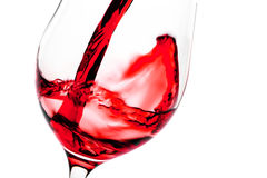 Red wine pouring in glass goblet Stock Image