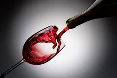 Red wine pouring Royalty Free Stock Photos