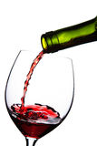 Red wine pouring into glass isolated Stock Photo