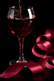 Red wine pouring into glass isolated Royalty Free Stock Photography