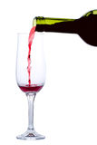 Red wine pouring into glass isolated Royalty Free Stock Image
