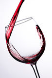 Red wine pouring in glass Stock Photos