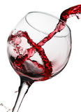 Red wine pouring in glass isolated on white background Stock Images