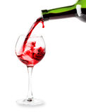 Red wine pouring into a glass Stock Photos
