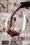 Red wine pouring Royalty Free Stock Images