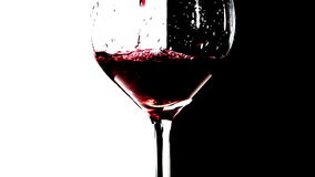 Red wine pouring into glass stock footage