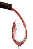 Red wine pouring into glass Royalty Free Stock Images