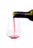 Red wine pouring into a glass Royalty Free Stock Photo