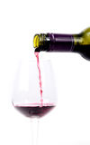 Red wine pouring into a glass Stock Photography