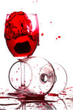 Red wine pouring into a glass on white background Royalty Free Stock Photos