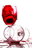 Red wine pouring into a glass on white background Stock Image
