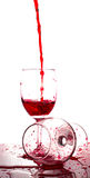 Red wine pouring into a glass on white background Stock Photos