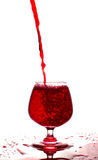 Red wine pouring into a glass on white background Stock Photo