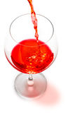 Red wine pouring  isolated Royalty Free Stock Image