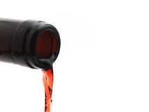Red wine pouring off the bottle Stock Images