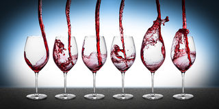 Red wine pouring row Stock Photography