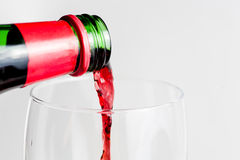 Red wine pouring side view Stock Photos