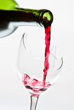 Red wine pouring to the broken glass royalty free stock photos