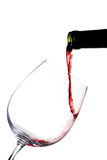 Red wine pouring on white Royalty Free Stock Image