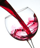 Red wine pouring into wine glass Royalty Free Stock Images
