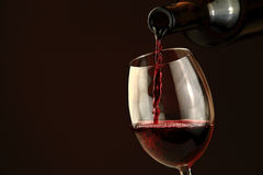 Red wine pouring into a wine glass Stock Image