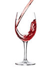 Red wine pouring into wine glass isolated Stock Photos