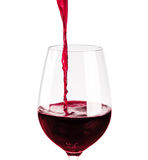 Red wine pouring into wine glass Stock Images