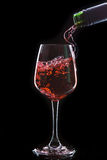 Red wine pouring into a wine glass Stock Photos