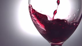 Red wine pouring into wine glass stock video footage