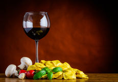 Red wine with Ravioli Pasta on Copy Space Stock Photography