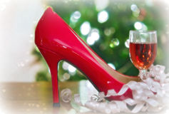 Red wine in red high heel Stock Image