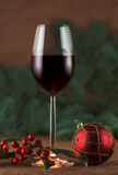 Red wine, red holly Royalty Free Stock Photo
