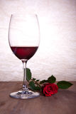 Red wine and red rose Stock Photography
