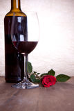 Red wine and red rose Stock Image