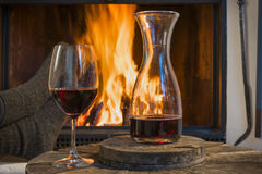 Red wine relaxing fireplace in autumn winter Royalty Free Stock Photography