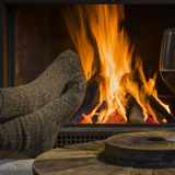 Red wine relaxing at fireplace in winter Stock Photos