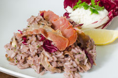 Red wine risotto with fried ham Royalty Free Stock Images